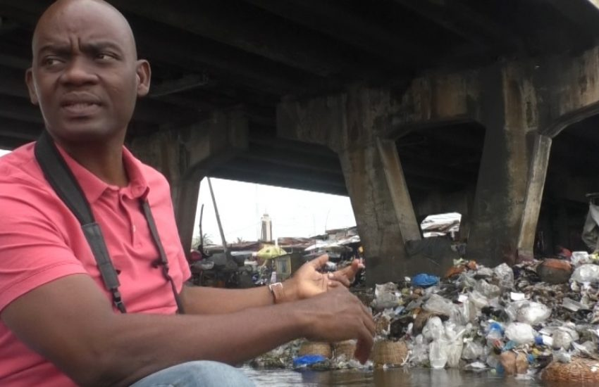 Director of the Benin Environment and Education Society (BEES) shows plastic pollution in Benin