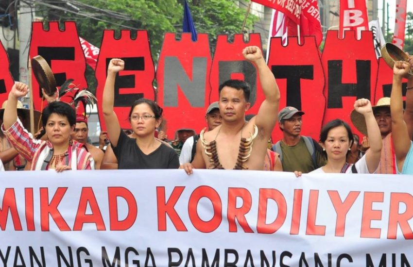 Group of people from Cordillera Peoples Alliance holding a large protesting sign. (Photo: Cordillera Peoples Alliance)